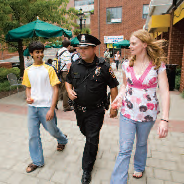 photo of officer escorting citizens